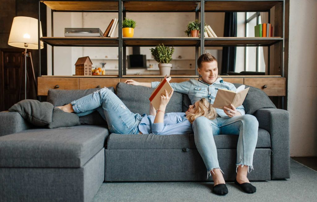 love-couple-resting-on-comfortable-couch-at-home-5R78BFY